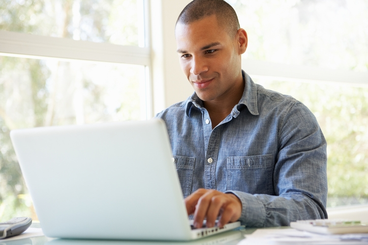 Man sitting at a desk using a laptop